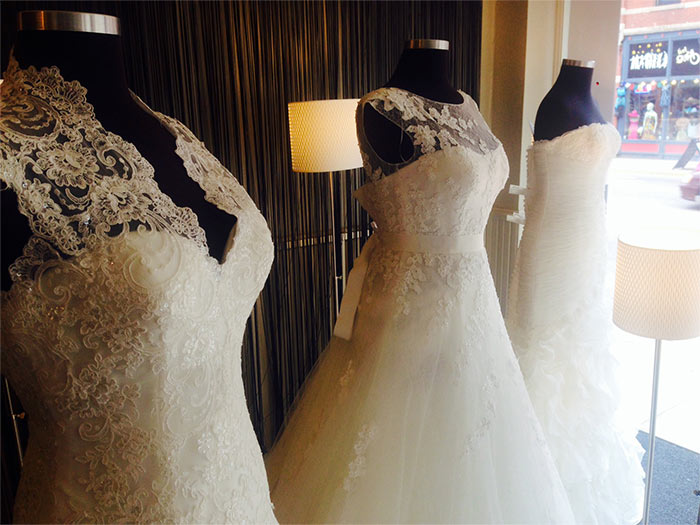 wedding dresses in front window at our shop