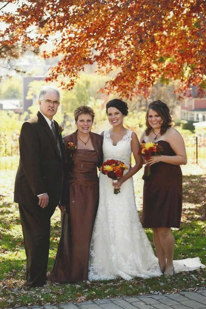 a bride with her family in the fall