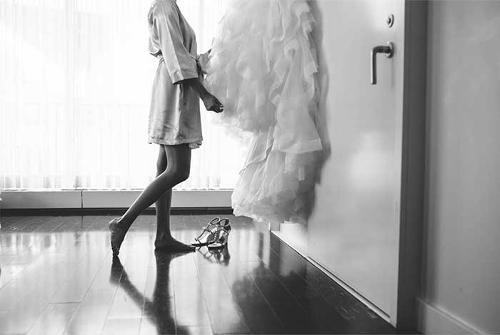 a bride inspecting her wedding dress