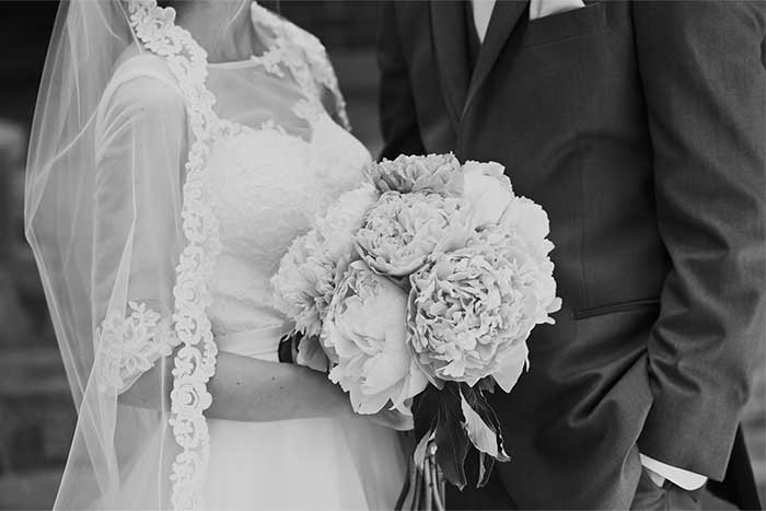 a wedding couple holding a bouquet