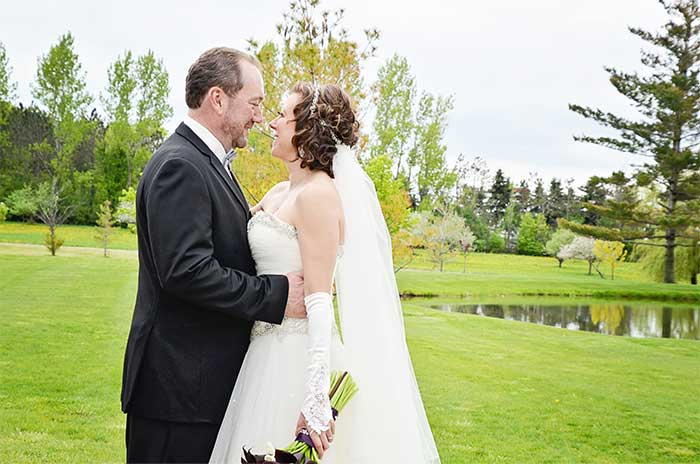 a wedding couple near a pond